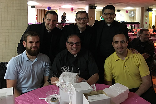 Fr. Gus Puleo (center) with seminarians from St. Charles Borromeo Seminary